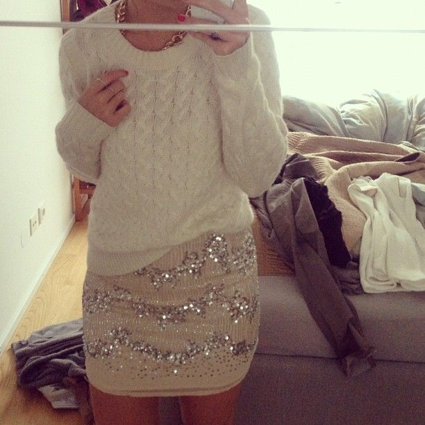 love a casual cozy sweater paired with a shimmery skirt.